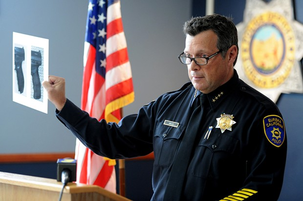 Eureka Police Chief Andy Mills holds up a side by side comparison of the hilt of a Walther PPQ replica and of real Walther PPQ during a press conference on the officer involved shooting death of McCain. Mills stated that following the shooting, officers recovered a replica Walther PPQ from McCain. - MARK MCKENNA