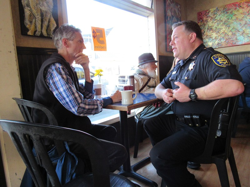 Eureka resident Jim Hight (left) listens as Capt. Steve Watson of the Eureka Police Department explains their policing strategy. - LINDA STANSBERRY