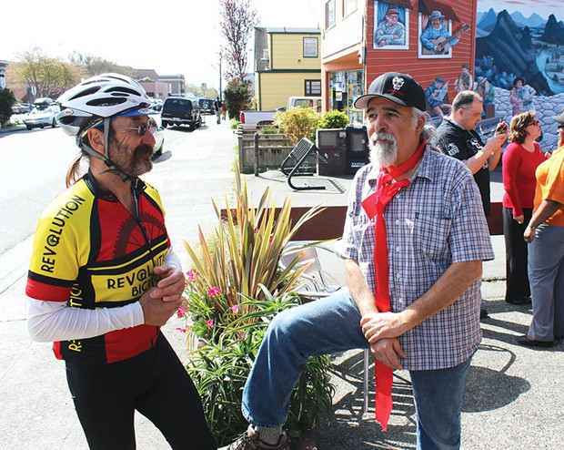 "Former Arcata Mayor ""Bad"" Bob Ornelas chats with Los Bagels owner Dennis Rael at a ribbon-cutting ceremony marking the business' 30th anniversary. - PHOTOS BY BOB DORAN"