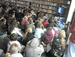 Fourth and fifth graders at Down's Prairie Elementary School watch the inauguration of President Barack Obama. Photo by Ryan Burns