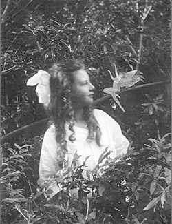 "(ELSIE WRIGHT, 1901-1988; PUBLIC DOMAIN) - Frances Griffiths and friend in one of the 1917 ""Cottingley Fairy"" photos."