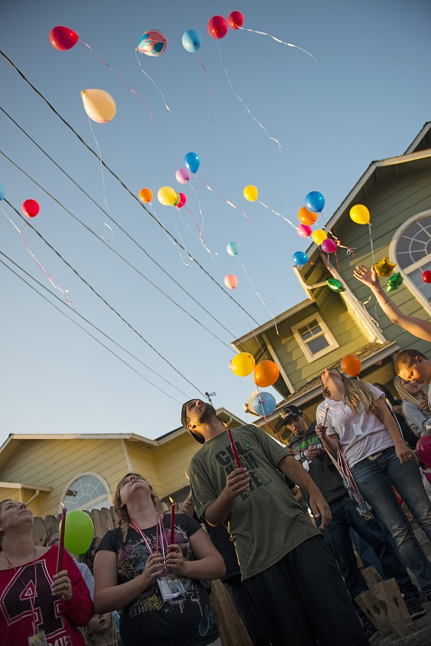 """Friends and family release balloons during a vigil for Thomas """"Tommy"""" McClain who was fatally shot by Eureka police early Wednesday morning. - MARK MCKENNA"""