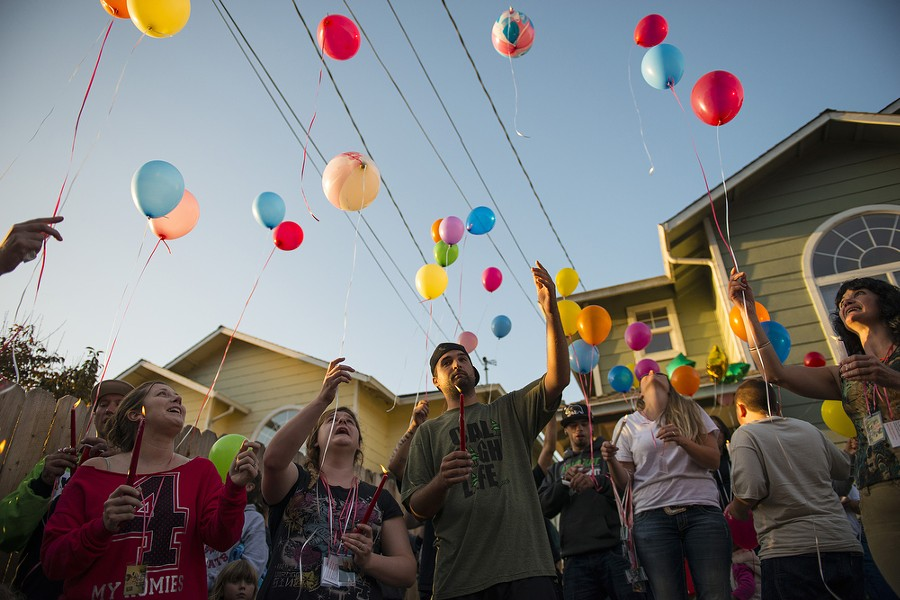 "Friends and family release balloons during a vigil for Thomas ""Tommy"" McClain held at the scene of Wednesday's shooting. - MARK MCKENNA"