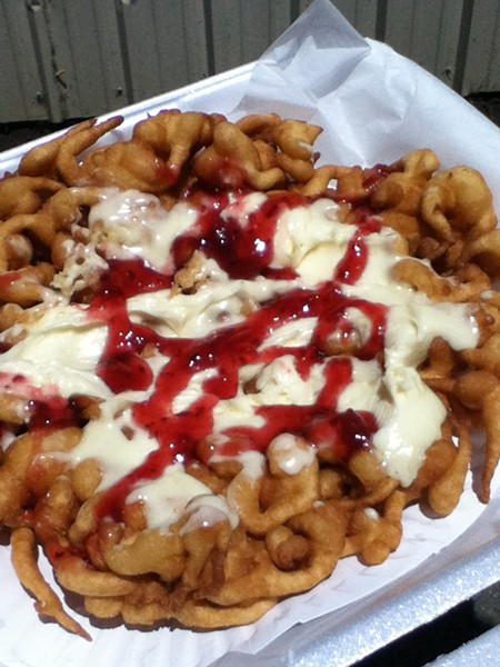 Funnel cake topped with sweet cream and raspberry sauce. - JENNIFER FUMIKO CAHILL