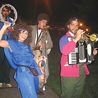 "Glasnost Glasnost Band marching on Arcata Plaza: Davf (Barney Baggett) on clarinet, ""Featured Dancer"" Tatiana (Ida Fugli) on tambourine, Joff (Adam Curvin) on saxophone and Poosh (Jamie Van Camp) on trumpet and accordion; photo by Bob Doran"