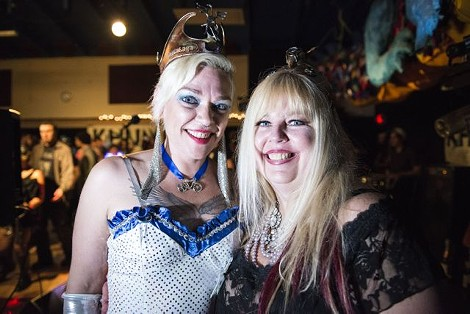 Gloria Kiddnetica (left) stands with Queen Glitterina just after the passing of the crown. - MARK MCKENNA