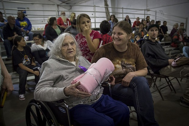 Honored Elder Otha Sadler, 97, receives a blanket during the Elder's Gifting Ceremony. - MANUEL J. ORBEGOZO