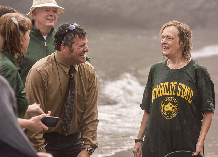 """HSU registrar Clint Rebik (left) compares experiences with HSU President Lisa Rossbacher after emerging from their """"sustainable"""" Ice-Bucket Challenge. - MARK LARSON PHOTOGRAPHY"""