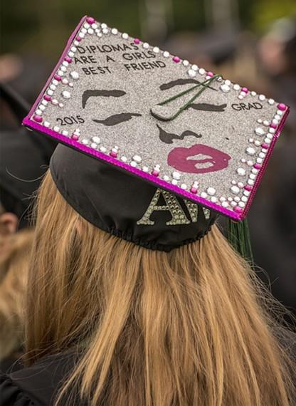 "Dance major Amethyst Avra Weburg created my favorite inscription on her mortarboard hat: ""Diplomas are a girls (sic) best friend."" - MARK LARSON"