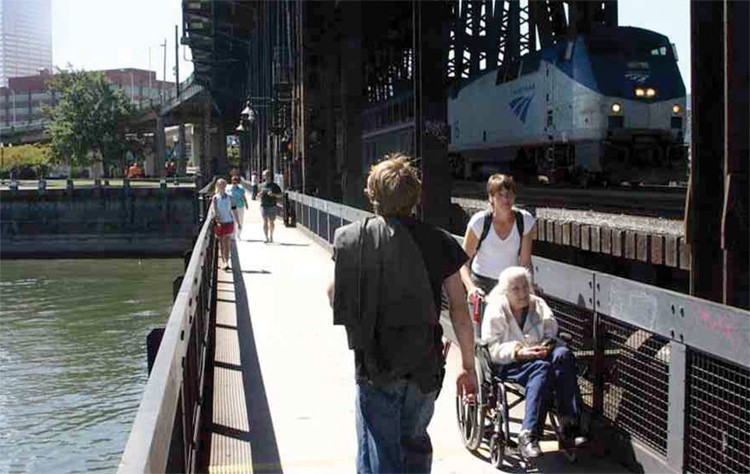 """In Portland, Ore., a bike and pedestrian trail is attached to the railroad bridge. - FROM THE 2012 """"HUMBOLDT BAY RAIL-WITH-TRAIL"""" REPORT BY GHD OF EUREKA (FORMERLY WINZLER & KELLY)."""