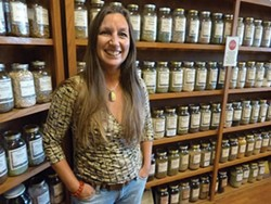 PHOTO BY BOB DORAN - Irene Lewis bought Moonrise Herbs in 2004, after a long relationship of working in the store and selling her own herbal products there.