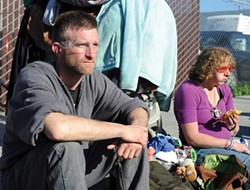 PHOTO BY MARK MCKENNA - J-son and Brittany sit across from St. Vincent Depaul's free dining facility in Eureka.