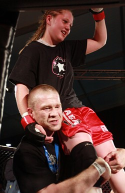 PHOTOS BY ERIK FRASER,  COURTESY BLUE LAKE CASINO. - Jason Kyle carries his 16-year-old daughter Taneisha on his shoulder after her first-ever mixed martial arts cage fight.
