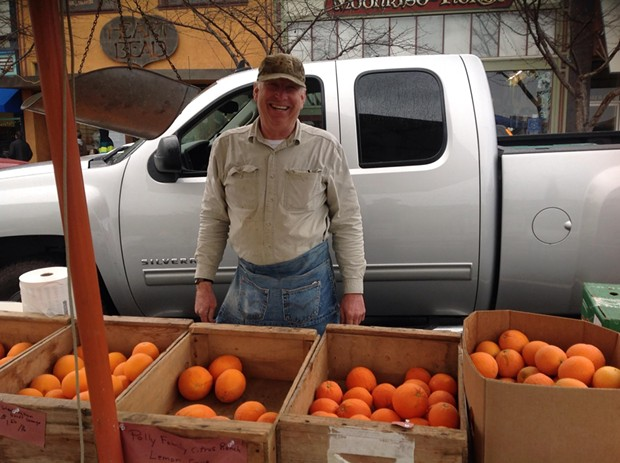 Jim Polly from Lemon Cove selling his family farm's citrus at the Arcata Winter Market. - PHOTO BY BOB DORAN