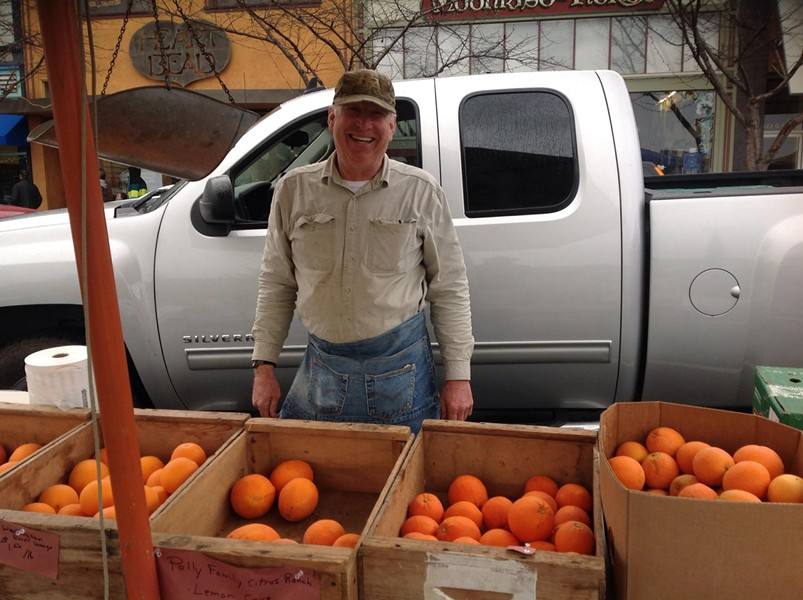 Jim Polly from Lemon Cove selling his family farm's citrus at the Arcata Winter Market. - PHOTO BY BOB DORAN