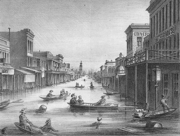 K Street, Sacramento, in the aftermath of the 1861-62 Great Flood. One-quarter of taxable real estate in California was destroyed, resulting in the state declaring bankruptcy. - LITHOGRAPH FROM U.S. GEOLOGICAL SURVEY