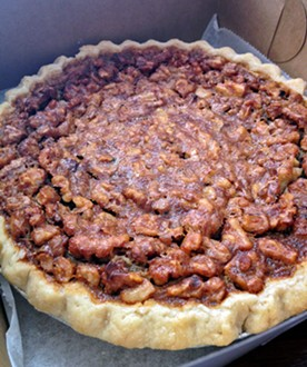 Kentucky Derby pie comes with a kick of Bourbon. - JENNIFER FUMIKO CAHILL