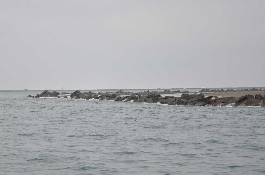 Water pushes over the jetty wall onto the north spit beach. - GRANT SCOTT-GOFORTH
