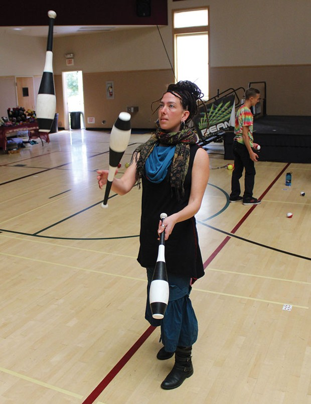Kira Davis practices with juggling clubs at the 14th annual Humboldt Juggling Festival, which ran all weekend at the Arcata Community Center. - PHOTOS BY BOB DORAN.