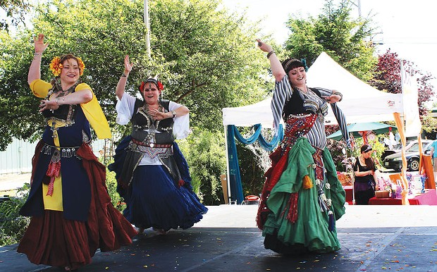 Kristie Alberti, Amanda Loftis and Megz Madrone of Tribal Oasis Belly Dance were among the scores of entertainers on Saturday, May 17, the first day of the Humboldt Arts Festival at Arcata's Creamery District. - PHOTOS BY BOB DORAN