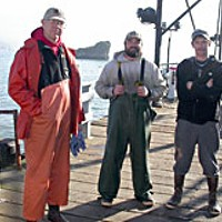 People of the Crab L-R: Mike McBrayer, skipper of the*Sundown*, with crew Jason Rau and Mike Van Duzer, on the pier in Trinidad. Photo by Heidi Walters.