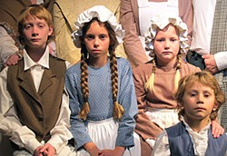 (L to R) Alex Sutter as Peter Cratchit, Gaia Denisi as Miranda Cratchit, Allison Boltzen as Gillian Cratchit, Dori Denisi as Tiny Tim, from the cast of NCRT's A Christmas Carol.