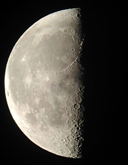 Last quarter moon. The huge circular feature is Mare Imbrium, an ancient lava-filled crater some 800 miles across.