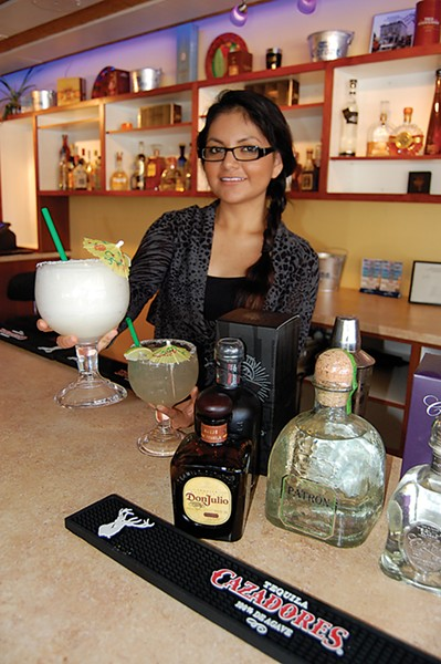 left Rita's margarita mistress Isamar Carrasco serves 'em strong. - PHOTO BY ANDREW GOFF