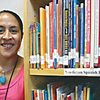 "Teacher's Prep — Knuckling down for a hectic nine months as the school year starts Lisa Cardenas of McKinleyville's Morris Elementary works 50-60 hours a week prepping: ""Maintaining a quick pace and high interest in every subject, every moment of the day is really hard."" Photo by Yulia Weeks."