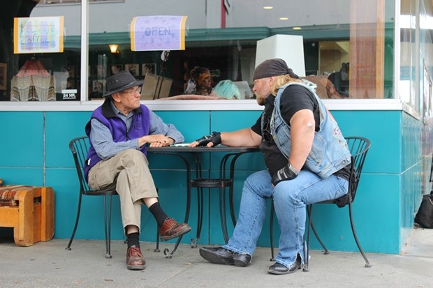 "Stan Elsworth, described as his producer as a ""big, burly biker dude"" with an interest in history, talks with local historian Ray Hillman in Eureka. - THADEUS GREENSON"