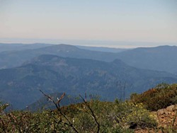 PHOTO BY BARRY EVANS - Looking west from Salmon Mountain to the Pacific across the width of Humboldt County. Those granite-like rocks were formed underground as a result of plate tectonics 170 million years ago.