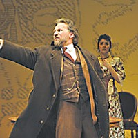 Lopakhin (Armando DurÁn) exults after buying the cherry orchard. Dunyasha (Nancy Rodriguez), looks on. Photo by David Cooper.