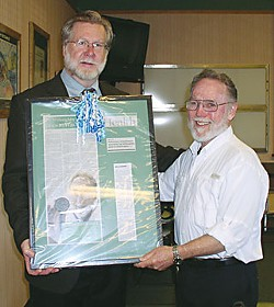 Mad River Hospital CEO Doug Shaw (left) awards a plaque to Carl Willoughby. Photo by Vicky Sleight.