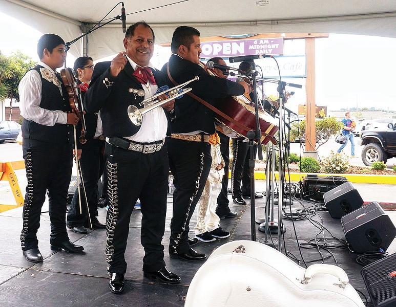 Mariachi Real de Mexico play real Mexican folkloric music to help celebrate the 20th anniversary of Wildberries Marketplace on Saturday, Aug. 16, in Arcata. - PHOTO BY BOB DORAN