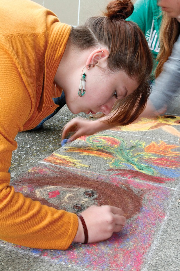 McKinleyville High School student Wendy Witte creates one of the pastel drawings on the school quad. Materials will be supplied for people who want to add their own bit of creativity during McKinleyville's arts night. - PHOTO COURTESY MCKINLEYVILLE ARTS NIGHT.