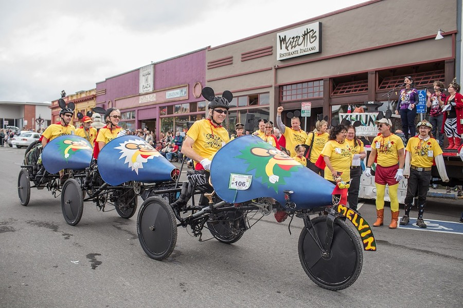 Members of Melven make their way past the audiences and plaza before the race. - ALEXANDER WOODARD