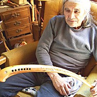Love Me, I'm a Lamprey Merk Oliver holding one of the eeling hooks he carved. Photo by Heidi Walters