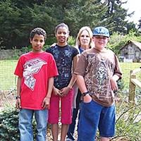 The CASA Michael, Angela and Bradley with their adoptive mom, Jan Carr, on their farm in Arcata. Photo by Heidi Walters