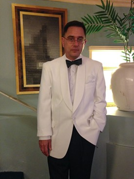 Michael Logan goes full Bogart in a white dinner jacket. - JENNIFER FUMIKO CAHILL