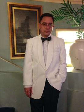 Michael Logan goes full Bogart in a white dinner jacket. - JENNIFER FUMIKO CAHILL
