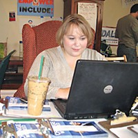 Ground Game Miranda Braatz, field organizer for the Colorado Democratic Party, rearranges data for the next day's canvass and phone shifts. Photo by Judy Hodgson.