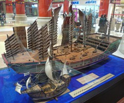 "PHOTO BY LARS PLOUGMANN, CREATIVE COMMONS LICENSE - Model of a Ming-dynasty Chinese ""treasure ship"" dwarfs a model of one of Columbus' ships in a display in the Ibn Battuta Mall, Dubai."