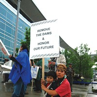 Klamath: Direct Action! Molli White,with her son Chaas, demonstrate at Warren Buffett's 2006 shareholders meeting in Omaha. Photo courtesy the Klamath-Salmon Media Collaborative.