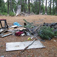 Tree Cop More trash fouling the Six. Phillips digs through illegal dumps such as this to find incriminating identification Illegal dumps occur continuously on the forest, and if the dumper isn't caught the Forest Service has to clean it up. Photo by Heidi Walters