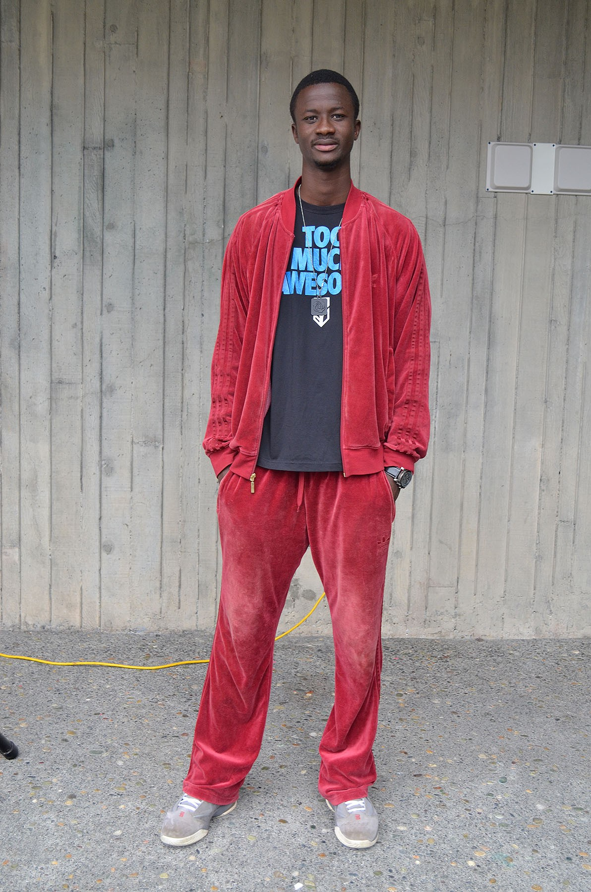 Moussa Sy, a freshman environmental engineering student is enjoying the cool climate here, a change from his home country of Mali. He's old-school in a velour tracksuit and Adidas. - PHOTO BY SHARON RUCHTE