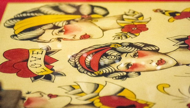 """My favorite sight-seeing activity was to review the original art work done by the tattoo artists along with the familiar """"flash"""" designs. - MARK LARSON"""