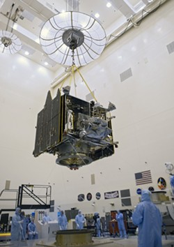 PHOTO BY TIM JACOBS, COURTESY OF NASA - NASA's Mars Atmosphere and Volatile EvolutioN (MAVEN) spacecraft at the Kennedy Space Center in Florida, August 2013. The mission will study Mars' upper atmosphere starting in the fall of 2014.
