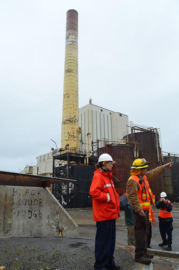 EPA coordinator Steve Calanog and Coast Guard Ensign Leigh Van Lear explain the pumping process. - GRANT SCOTT-GOFORTH