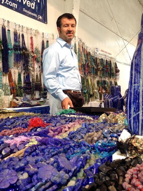Aman khan Zadran, of Afghan Gem Jewelry, at the Gem Faire in Eureka Saturday. - PHOTO BY HEIDI WALTERS