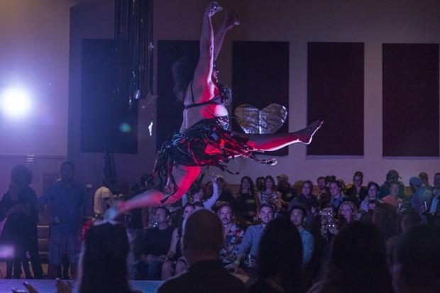 Jayla Rose Sullivan of the Caravan of Glam leaps during the group's performance. - ALEXANDER WOODARD